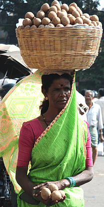 Woman balance load on head